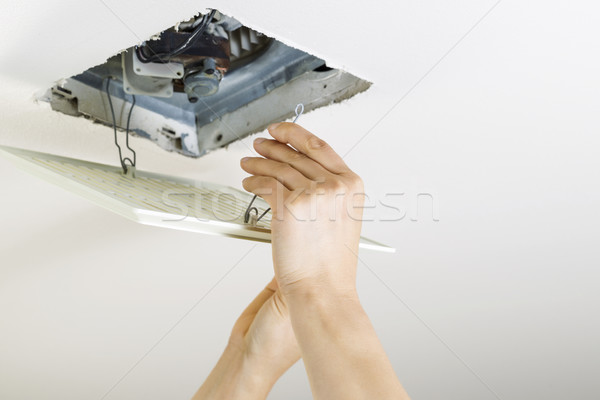 Installing Clean Bathroom Fan vent cover  Stock photo © tab62