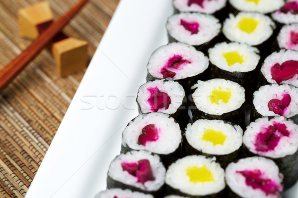 Large plated filled with Pickled Hand Rolled Sushi  Stock photo © tab62