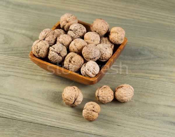 Unshelled Walnuts in Bowl  Stock photo © tab62