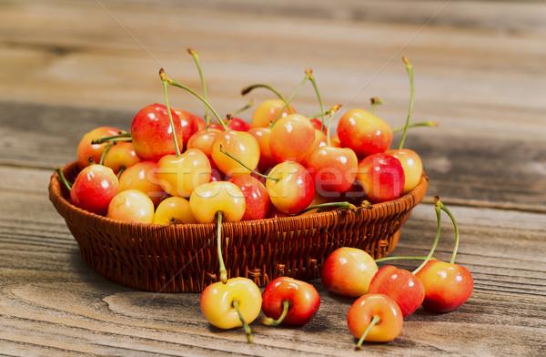 Juicy Golden Rainier Cherries in Basket on Rustic Wood Stock photo © tab62