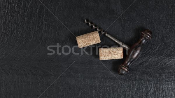 Overhead view of vintage corkscrew on black slate background  Stock photo © tab62