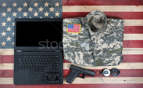 Overhead view of USA military equipment and laptop computer on r Stock photo © tab62
