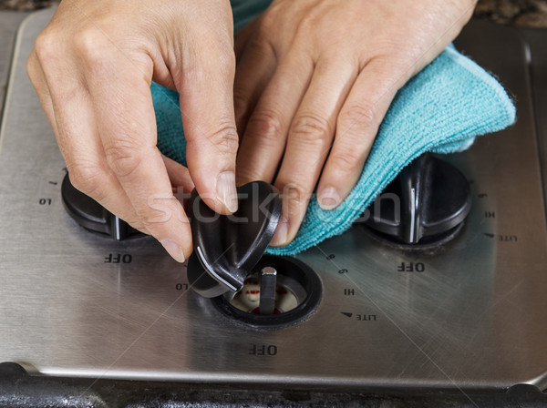 Cleaning dial knob on gas stove top range  Stock photo © tab62