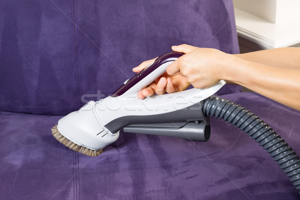 Cleaning Leather Sofa with Vacuum Brush Stock photo © tab62