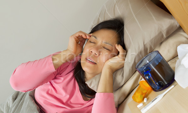 Mature woman with headache  Stock photo © tab62