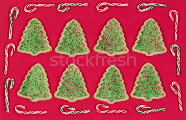 Christmas tree shaped cookies surrounded by candy cane border on Stock photo © tab62