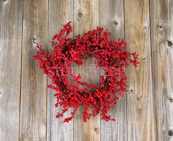 Red holly berry wreath on aged wooden boards  Stock photo © tab62
