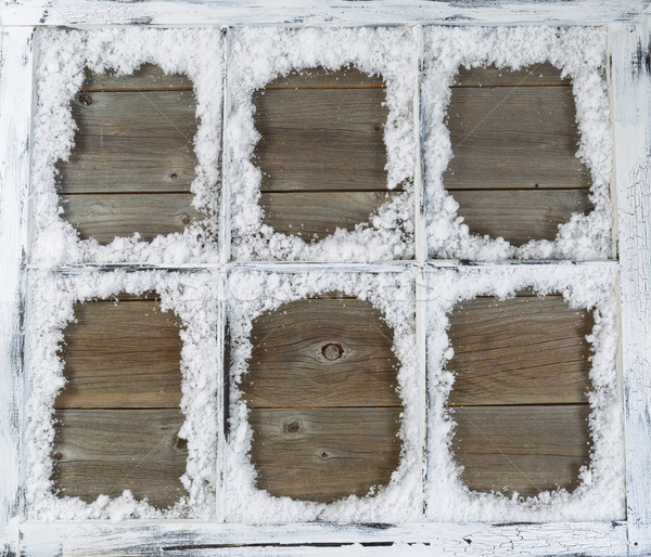 Vintage window covered in powdered snow with rustic wood in back Stock photo © tab62