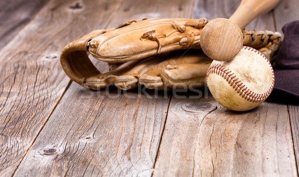Used baseball equipment on rustic wooden boards Stock photo © tab62