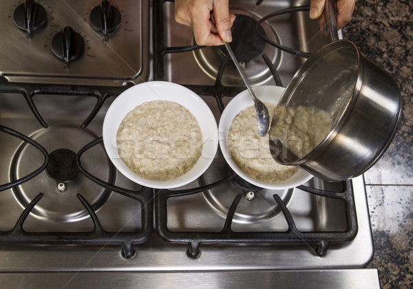 Pouring Oatmeal into Breakfast Bowls   Stock photo © tab62
