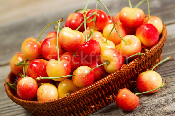 Freshly Picked Golden Rainier Cherries in Basket on Rustic Wood  Stock photo © tab62