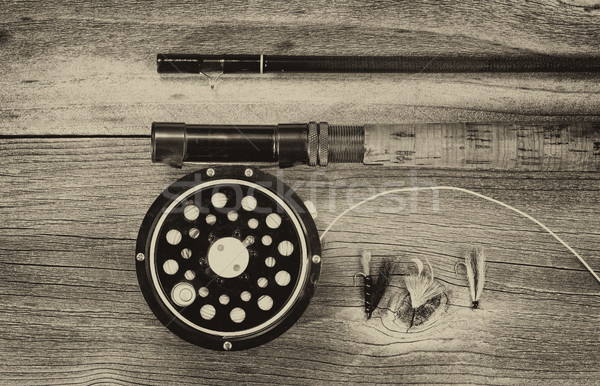 Vintage fly reel and rod on aged wood  Stock photo © tab62