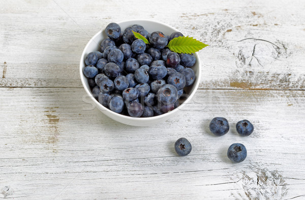 Freshly picked blueberries on rustic white wooden boards Stock photo © tab62