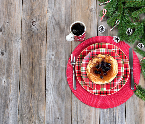Christmas breakfast setting with evergreen branches on rustic wo Stock photo © tab62