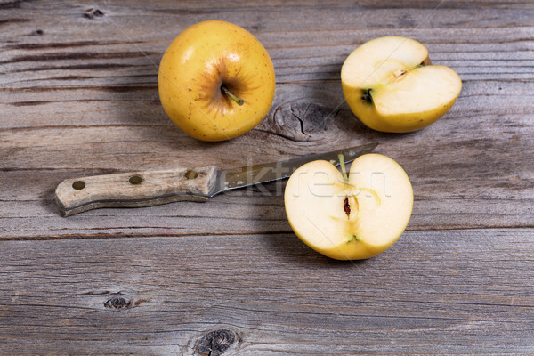 Freshly sliced golden apple on rustic wooden boards  Stock photo © tab62