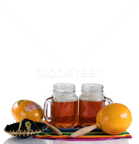 Beer with party objects on glass table isolated on white backgro Stock photo © tab62