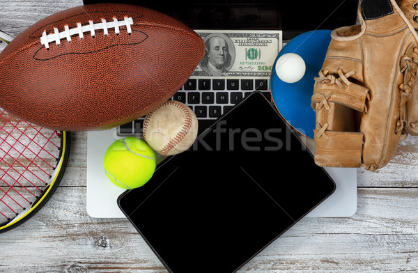 Betting on various sports with computer technology and money in  Stock photo © tab62