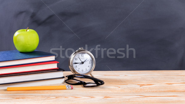 Back to school objects in front of erased black chalkboard Stock photo © tab62
