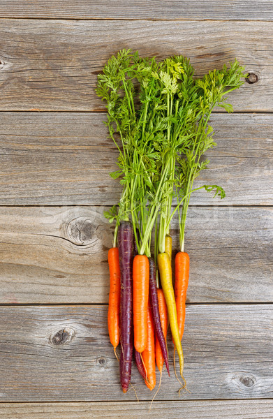 Rainbow carrots on rustic wooden boards  Stock photo © tab62