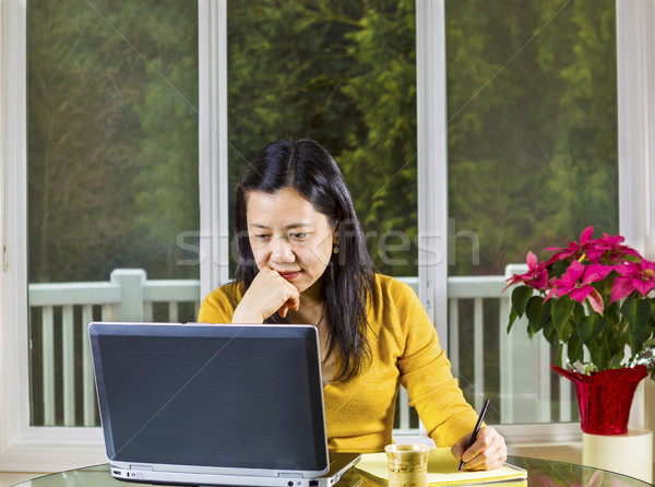 Mature woman working at home  Stock photo © tab62