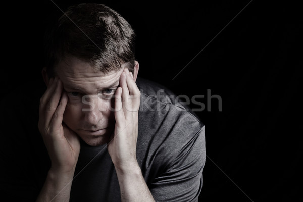 Mature man with headache from stress Stock photo © tab62