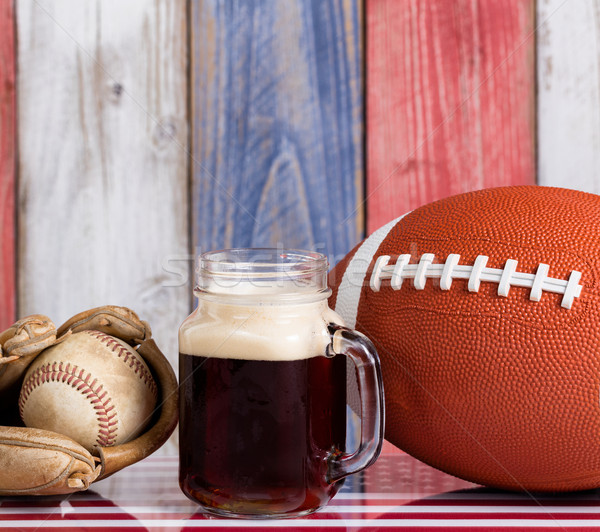 Beer and American sports objects with faded wooden boards painte Stock photo © tab62