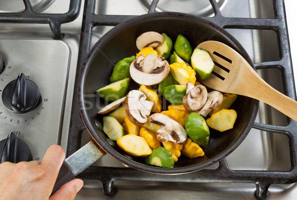 Zöldségek serpenyő fakanál közelkép kéz tart Stock fotó © tab62