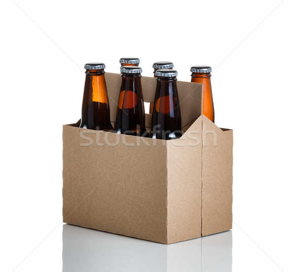 Six pack of glass bottled beer in generic brown cardboard carrie Stock photo © tab62