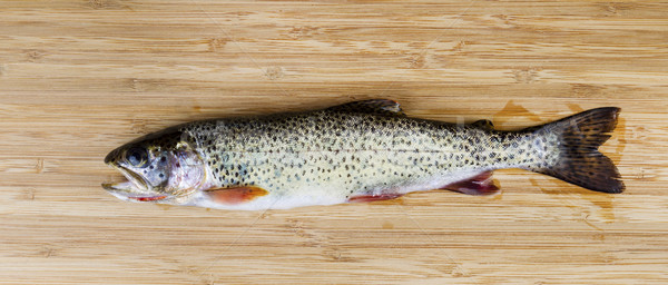Fresh Wild Trout on Natural Bamboo Wood Stock photo © tab62