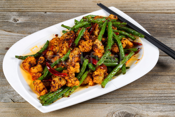 Crispy chicken and green bean dish ready to eat Stock photo © tab62