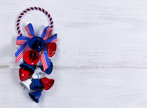 Holiday bells and ribbons on white wooden boards   Stock photo © tab62