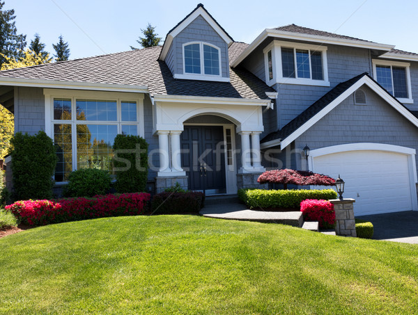 Well maintain front lawn of clean home during spring season  Stock photo © tab62