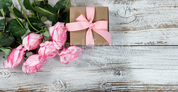 Six pink roses and gift on rustic white wooden background  Stock photo © tab62