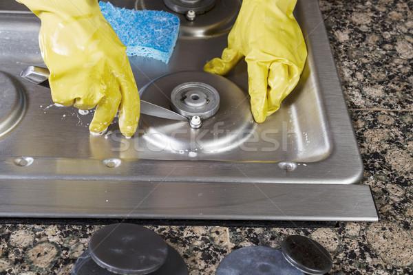 Reinigung Erdgas Herd Hände tragen Handschuhe Stock foto © tab62