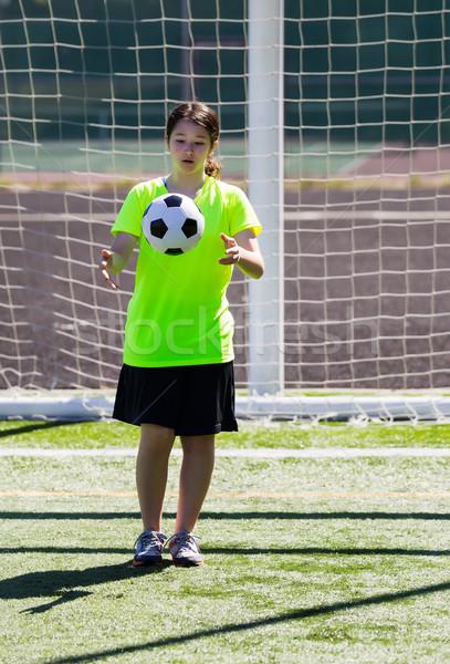 Młoda dziewczyna kopać piłka pionowy Fotografia Zdjęcia stock © tab62