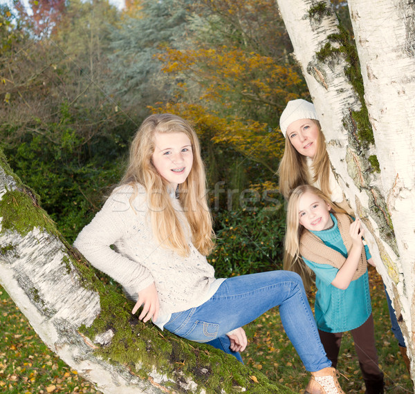 Oldest Daughter posing with mom and younger sister looking on  Stock photo © tab62