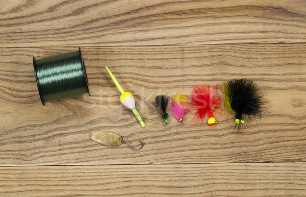 Assorted Fishing Equipment on Faded Wood  Stock photo © tab62
