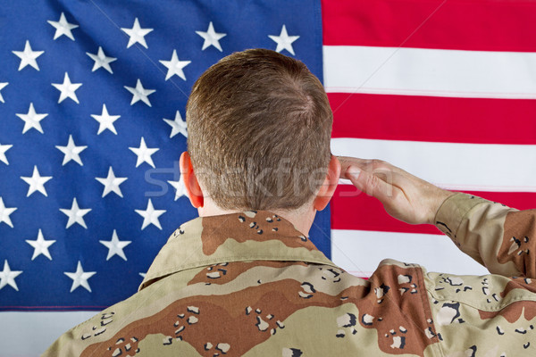 Male soldier saluting large USA Flag while indoors  Stock photo © tab62