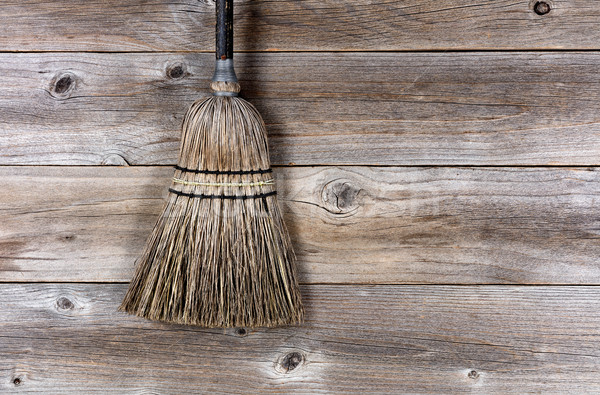 Old broom laying on rustic wooden boards  Stock photo © tab62