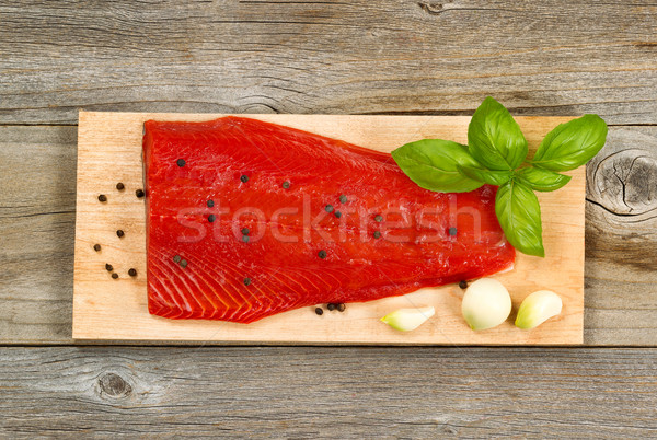 Fresh red salmon fillet on cedar cooking plank with spices and h Stock photo © tab62