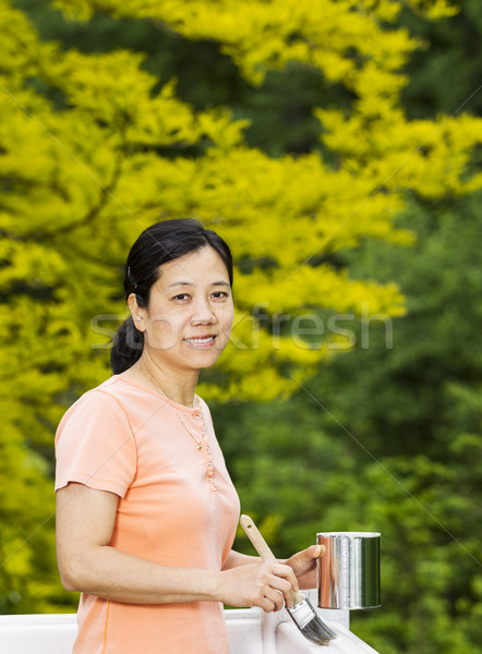 Mature woman preparing to paint outdoor deck railing  Stock photo © tab62