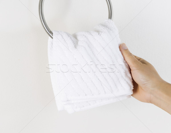 Female hand hanging up small white wash cloth  Stock photo © tab62