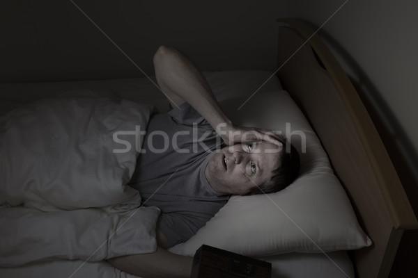 Homem maduro teto noite tempo cama Foto stock © tab62