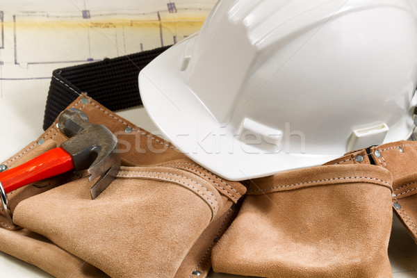 Construction contractor tools with blue print drawings in backgr Stock photo © tab62