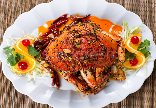 Whole cooked Dungeness crab with peanut sauce and spices on whit Stock photo © tab62