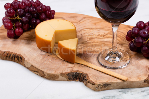 Gourmet cheese plus wine and grapes on wooden server  Stock photo © tab62