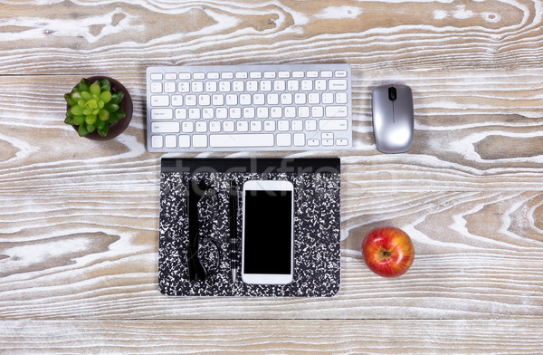 Fading desktop with stationery and technology Stock photo © tab62