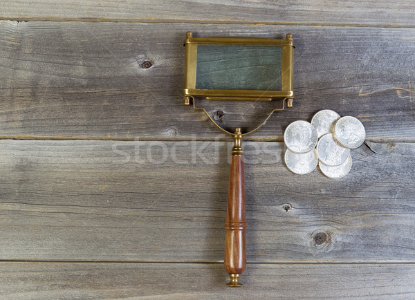 Silver Coins and Magnifying Glass on Wood  Stock photo © tab62