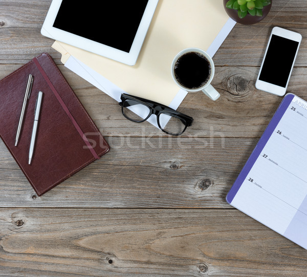 Desktop with a mixture of technology and traditional objects  Stock photo © tab62