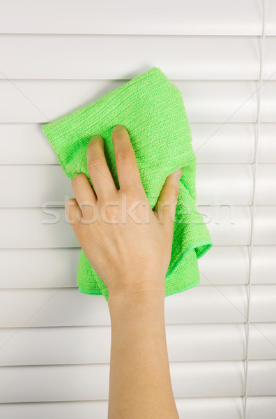 Stock photo: Dusting Window Blinds